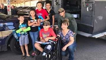 Manny Lopez, 8, who has osteosarcoma, visited the Las Cruces Police Department on July 26, 2017, and helped inspire officers to play in charity basketball game on Saturday, Aug. 19, 2017.
