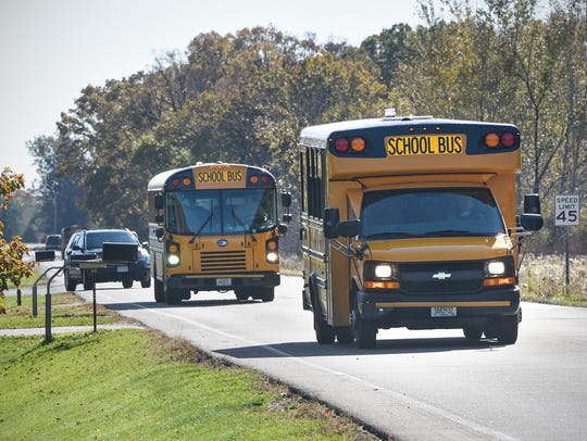Buses leave the loading area at Oak Hill Community