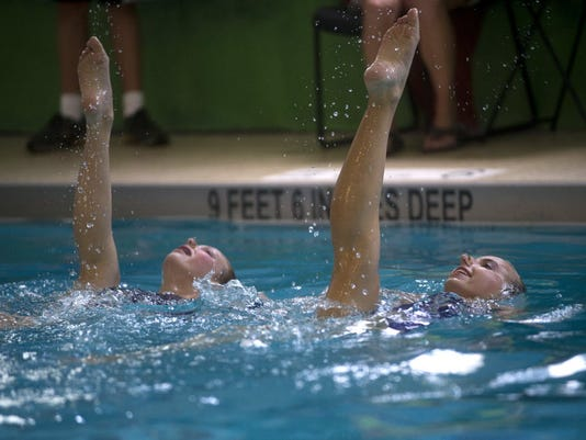 York Synchro-ettes Samantha Schlundt, 15, right, and Lydia Fairlamb, 12, compete in the 13-18 duets division during the 2012 Keystone Games synchronized swimming competition at the York YWCA in August 2012. Bring out your inner mermaid and learn some basics of synchronized swimming in this video. (Daily Record/Sunday News -- Kate Penn)