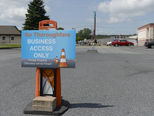 A sign notifies people that using the parking lot of Palmyra Bowling and the Sinkhole Saloon is not permitted as work began to repair a sinkhole underneath Rt. 422 in North Londonderry Township on Monday, August 4, 2014 and is expected to last three months. Lebanon Jeremy Long -- Lebanon Daily News