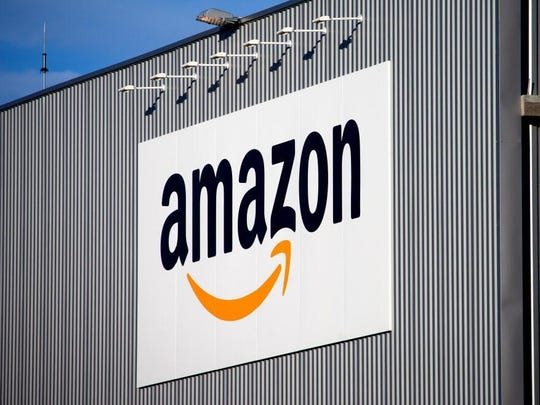 The Amazon logo is seen on the new logistics center
