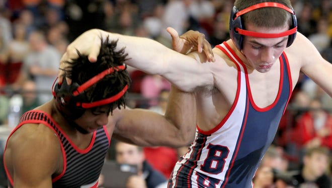 Belton-Honea Path High School's Trevor Mansfield wrestles South Pointe's Rodrick Whitlock in the 132-pound state championship match at the Civic Center of Anderson on Saturday. Mansfield lost 7-1.