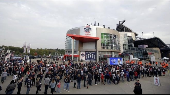 Fans line up to enter Gillette Stadium in Foxborough for an Oct. 2018 game. If fans are allowed to attend NFL games this season, Gillette will host only 20 percent of the stadium's capacity - about 13,000 people.