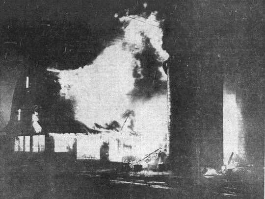 Two barns in flames on the Sunshine Farm in 1943.