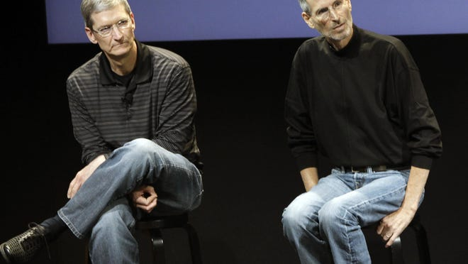 """Apple CEO Tim Cook, left, hopes new software coming to the iPhone will help ease a shortage of organ donors. The problem hit home when Apple co-founder Steve Jobs, right, endured an """"excruciating"""" wait for a liver transplant in 2009."""