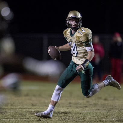 Basha quarterback Ryan Kelley looks to pass against