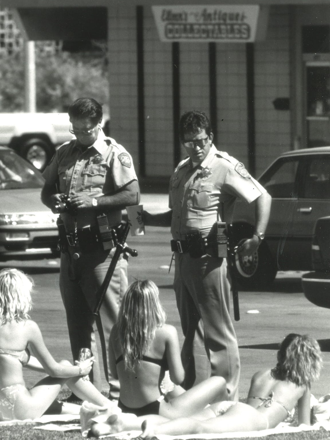Palm Springs police overlook sunbathers during spring break in 1988. In the wake of the '86, the city outlawed skimpy bikinis in an effort to send spring breakers elsewhere.