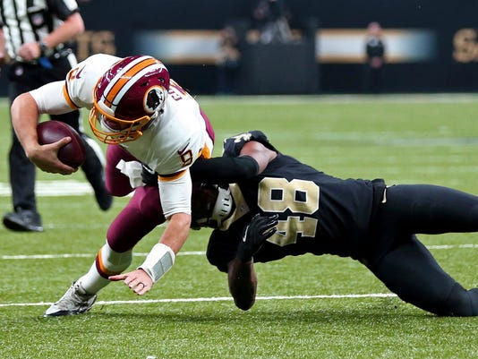 Washington Redskins quarterback Kirk Cousins (8) is tackled by New Orleans Saints free safety Vonn Bell (48) in the first half of an NFL football game in New Orleans, Sunday, Nov. 19, 2017. (AP Photo/Rusty Costanza)