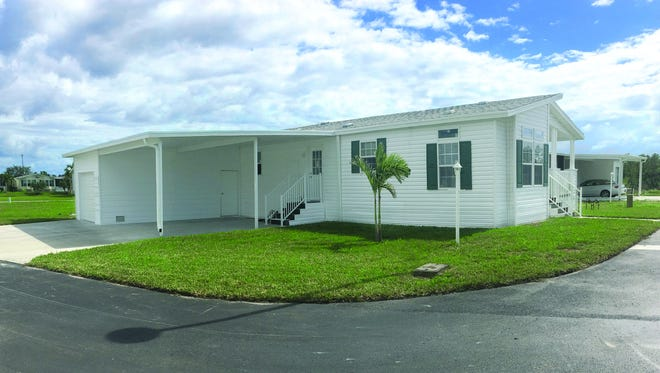 The Lexington manufactured home model by Jacobsen Homes is open in Tall Oaks of Naples.