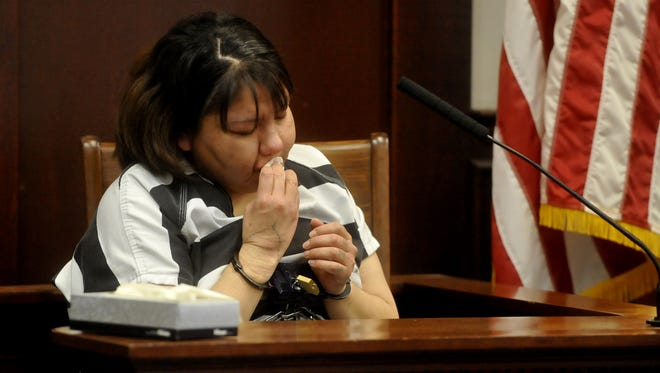 Summer Many White Horses wipes tears from her face as she sits on the witness stand to enter a guilty plea to negligent homicide and tampering with evidence in the death of her 2-year old son.