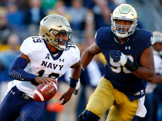 Navy quarterback Keenan Reynolds (19) is chased down by Notre Dame defensive lineman Isaac Rochell (90) during the second half of an NCAA college football game, Saturday, Oct. 10, 2015, in South Bend, Ind. Notre Dame won the game 41-24. (AP Photo/Jeff Haynes)