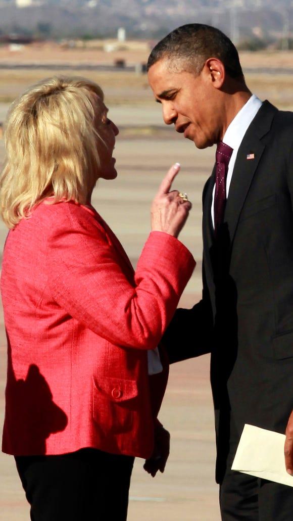 Arizona Gov. Jan Brewer points at President Barack