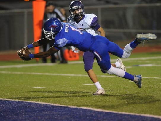 Cooper's Myller Royals stretches the ball over the