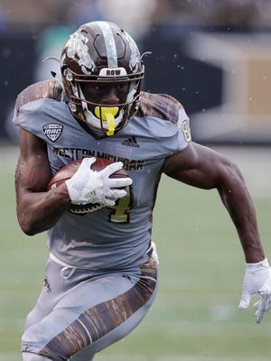 Western Michigan wide receiver Corey Davis (84) runs for a touchdown after a catch during the first half of an NCAA college football game against Buffalo , Saturday, Nov. 19, 2016 in Kalamazoo, Mich.