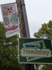 Signs welcome visitors to the annual shad festival.