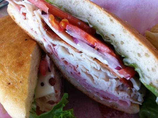 The Yacht Club ($8.95) at Marina Cafe in Micco comes on a ciabatta-style roll with smoked ham, turkey breast, bacon, Swiss cheese, tomato, lettuce and red onion.