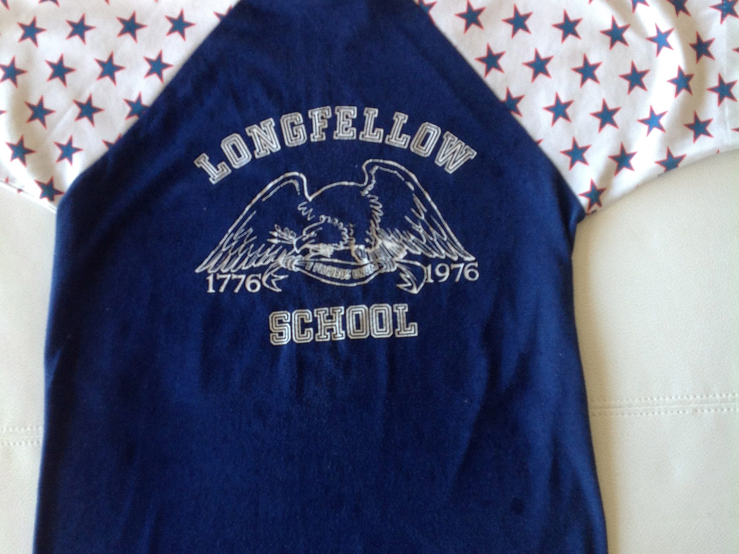 A Longfellow Elementary School T-shirt owned by Carrie