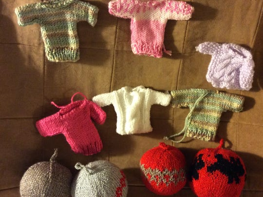 The knitted miniature sweaters are just as cute as