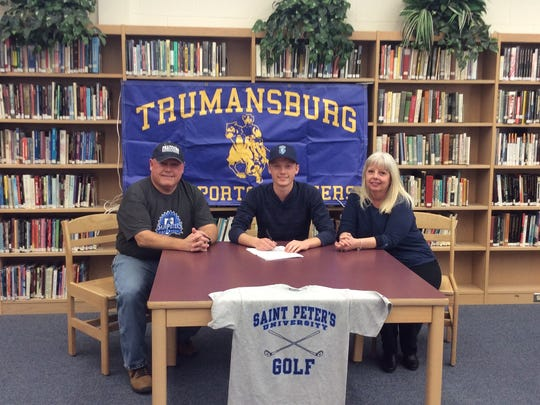Daniel Lapp, center, with his parents. The Trumansburg senior will be continuing his career at the Division I level next Fall, attending Saint Peter's University.