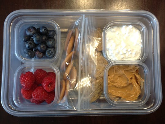 The Deconstructed American Classic has blueberries, raspberries, crackers, peanut butter and cottage cheese.
