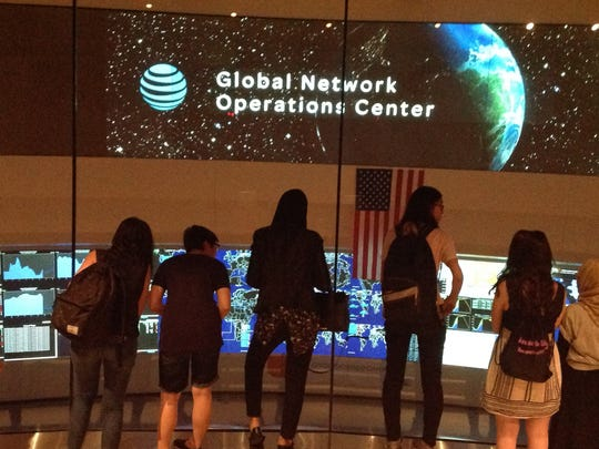 Students from the Girls Who Code Summer Immersion Program observe the operations of AT&T's Global Network Operations Center.