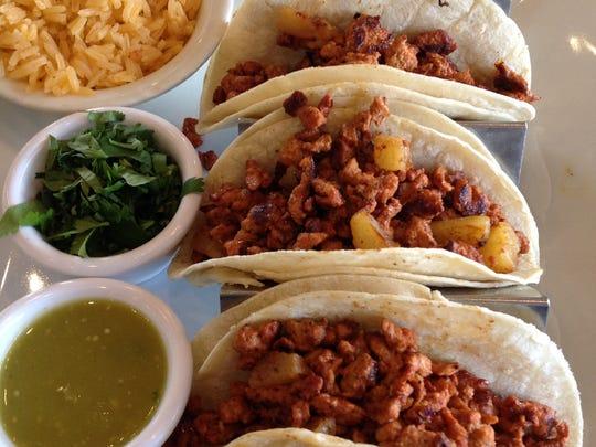 Famosos Tacos Al Pastor ($12.99) features grilled corn