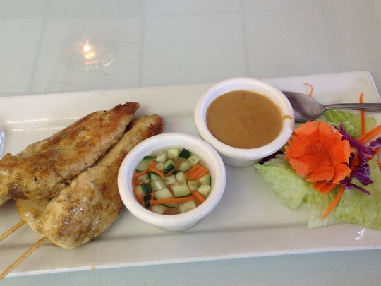 The chicken satay appetizer has tender chicken grilled and served with a peanut sauce ($6.99). It is big enough to share.