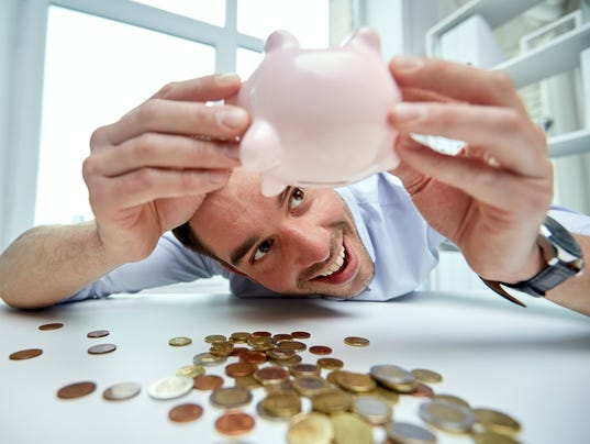 businessman with piggy bank and coins at office