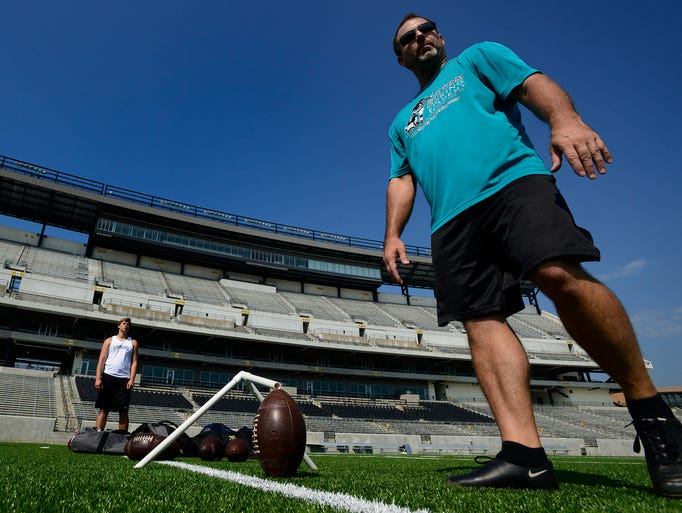 Former Jacksonville Jaguars kicker Mike Hollis teaches at a kicking camp at Hornet Stadium on the Alabama State University campus in Montgomery, Ala. on Thursday June 19, 2014.