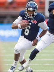 Rice quarterback Driphus Jackson (6) will try and get