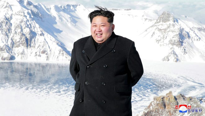 Kim Jong Un smiles after ascending North Korea's Mt. Paektu.