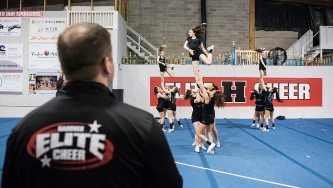 Hanover Elite Cheer owner Chris Topper coaches the Black Onyx cheer team during a practice on March 28, 2018.