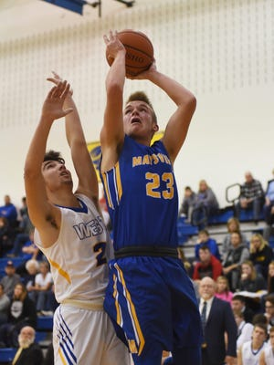 Maysville's Connor Sidwell puts up a shot against West Muskingum.