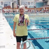 Emma Flinn won three gold medals in swimming at the National Senior Games.