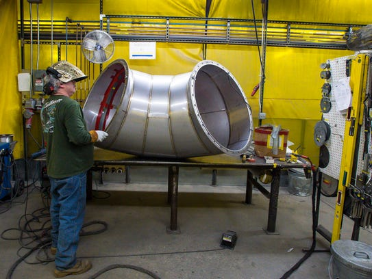 Steve Domina prepares to weld a section of pipe at