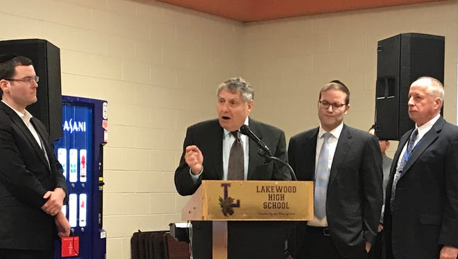 New Jersey state Sen. Bob Singer, a Republican, pledges to help find sufficient funding during the Lakewood High School athletes luncheon on Tuesday, Jan. 23, 2018. He's joined by Board of Education President Moshe Bender (left), and Township Committeeman Isaac Akerman and Township Manager Thomas Henshaw.
