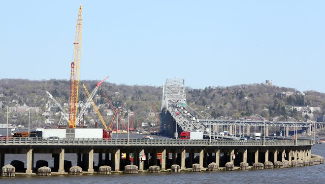 Cranes being used for the construction of the Tappan Zee Bridge replacement loom over the existing bridge April 24, 2014.