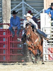 Palm City teen barrel racer Lauren Santagata riding