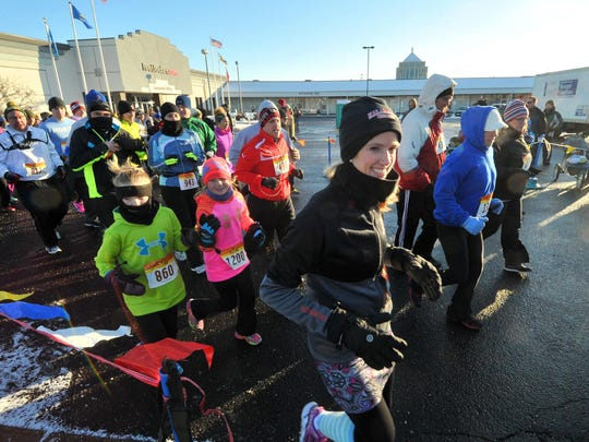 Hundreds of participants run Thursday's fifth annual Turkey Trot at Eastbay Corporate Headquarters in Wausau.
