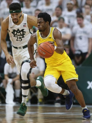 Michigan guard Derrick Walton Jr. steals the ball from Michigan State forward Kenny Goins in the first half on Jan. 29 at Breslin Center.