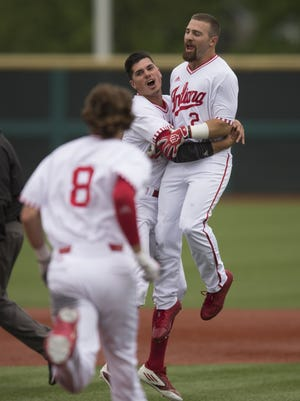 Alex Krupa (right), gets congratulations after hitting the game-winning RBA as IU beat Michigan 5-4 in 13 innings, the longest game in Big Ten baseball tournament history, Bloomington, Thursday, May 25, 2017.