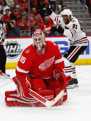 Red Wings goaltender Jimmy Howard reacts after allowing a goal in the first period against the Blackhawks at Little Caesars Arena on Thursday.
