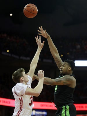 Nick Ward shoots over Wisconsin's Nate Reuvers at the Kohl Center on Sunday.