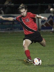 Mansfield Christian's Jared Mount kicks the ball during a game at Ontario last season.