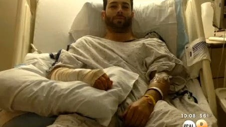 Model/actor Corey Sligh in his hospital bed.