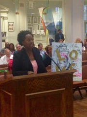 Natilee McGruder holds a piece of art created for the Peace Within MGM event at City Council Tuesday, Oct. 13.