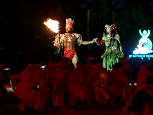 """Jermain Mendiola, left, plays Chaifi as Jowinalyn Mendiola plays Fu'una in the grand performance of """"Fu'una and Puntan and the beginning of Guam's people, tao tao tano."""" The performance was the highlight of the Festival of Pacific Arts opening ceremony held on May 22, 2016, at the Paseo Stadium in Hagåtña."""