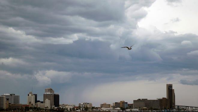 Dark clouds pass over the Corpus Christi skyline Saturday, June 30, 2012.
