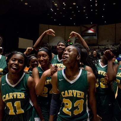 Carver players celebrate after defeating Lanier at