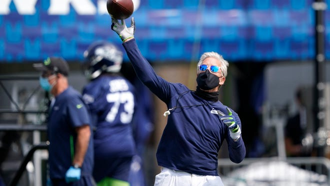 Seattle Seahawks head coach Pete Carroll throws a football during NFL football training camp, Wednesday, Aug. 12, 2020, in Renton, Wash.